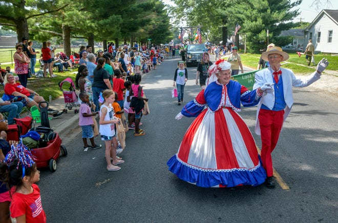 Larry and Shirley Hackman of Washington don their finest patriotic fashions as they dance the parade route on July 4, 2019, during the 49th annual West Peoria Fourth of July Parade. Because of the pandemic, the parade has been canceled for the second year in a row.