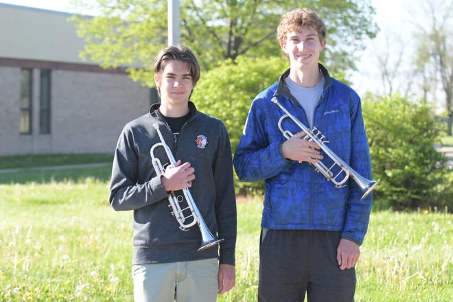 Kirksville All-State Band honorees Patrick Jennings, left, and Evan AuBuchon, right, pose with their trumpets.