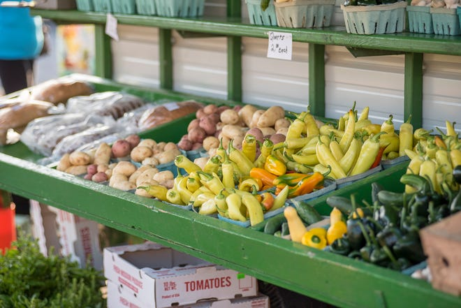 A produce stand sits full of vegetables at the Camdenton Farmers Market.