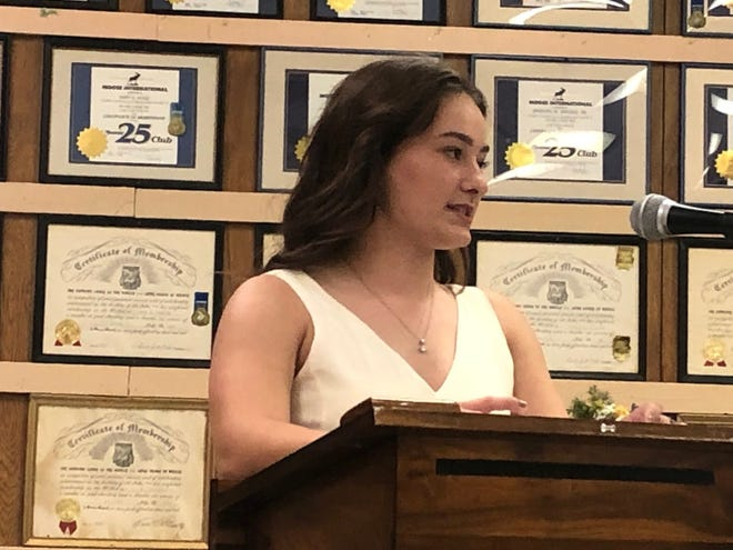 Award recipient Carlie Del Signore looks over at her family as she expresses her gratitude to all those who supported her.