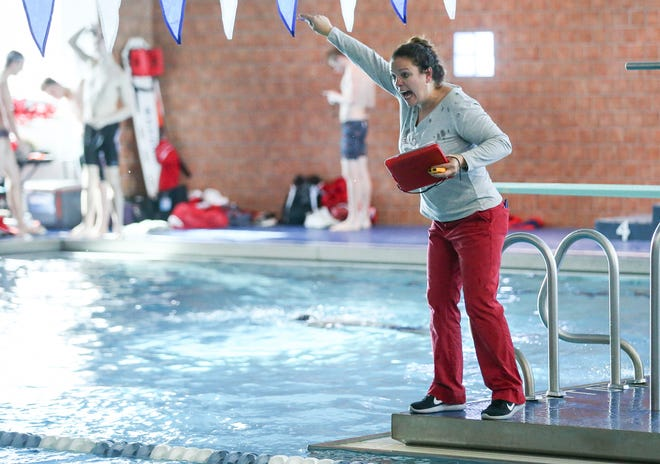Bedford coach Holly Scheffler cheers on her swimmers in the 500-yard freestyle during the 2019 Monroe County Swimming and Diving Championship.