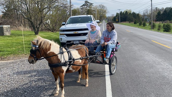 """Elva """"Mae"""" Sims takes a spin on County Road 39 on her 85th birthday."""