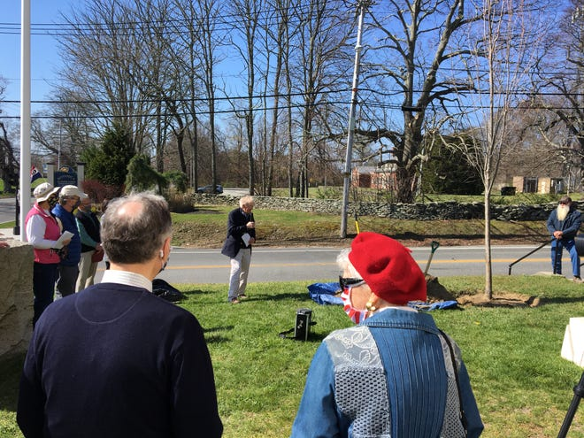 Town Historian Jim Garman offers remarks  at a tree planting in honor of Herb Hall.