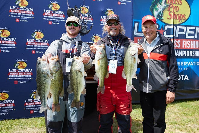 Oklahoma cousins Tanner and Alan Barton (l-r) stand next to Bass Pro Shops founder Johnny Morris after winning the the Bass Pro Shops U.S. Open qualifier on Lake Ray Roberts in Texas. The Bartons won $50,000 and now get to fish for $1 million in November on Table Rock Lake in Missouri.