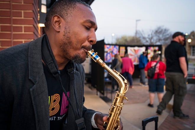 Saxophonist Vearl T is pictured performing during the first VIBES art walk in downtown Edmond.
