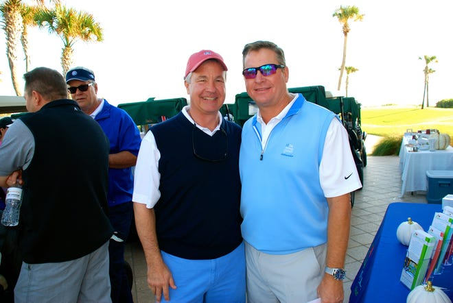 Honda Classic Executive Director Ken Kennerly (left), who serves on the Advisory Council for West Palm Beach-based Quantum House, and Southwest Greens Florida President Jim Walton, a Quantum House board member, get set for a round of golf at a recent Golf & Gobble fundraising event in Palm Beach. Quantum House will host its fifth annual tournament May 15 at Palm Beach Par 3.