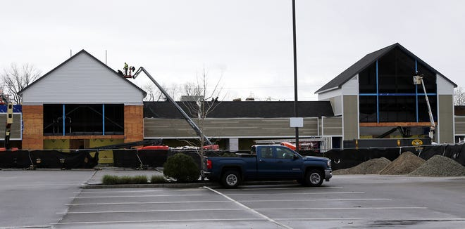 Construction workers are working toward the opening of a Whole Foods Market on Woodbury Avenue at the site of the former Shaw's in Portsmouth Friday, April 30, 2021.