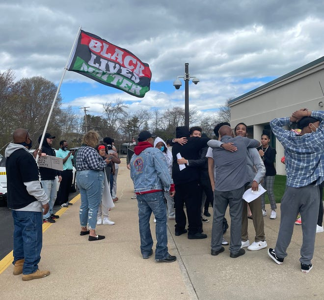 The scene outside Superior Court, Wakefield, on Friday as the three adult defendants in a convoluted rape case are released on their own recognizance to their families.