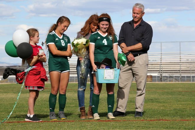 Isabelle Roquemore is embraced by her mother and joined by her family during the Lady Burros senior celebration after Tuesday's game. Roquemore scored the Burros' solo goal of the game, giving the girls a 1-0 win over Hesperia.