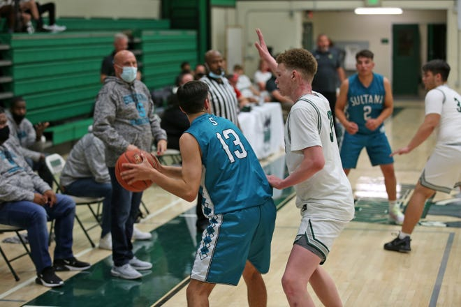Terrance Haywood keeps the pressure on, forcing Sultana into the corner of the court. Haywood led the team with 26 points Tuesday.