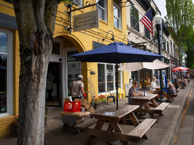 A lunch crowd takes advantage of outdoor seating on Main Street in Springfield.