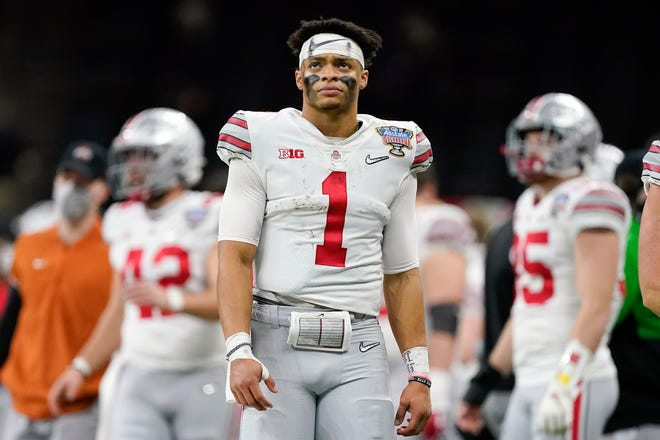 The Chicago Bears traded up in the first round Thursday with the New York Giants to select Ohio State quarterback Justin Fields.