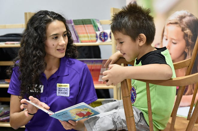Karen Aranjo with the Suncoast Campaign for Grade-Level Reading works with Jovani Alvarado, then 5, in 2019.