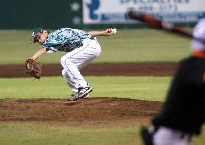 Venice pitcher Simon Yochum (28) delivers a pitch home against Sarasota during the district championship game in Venice. Venice went on to win 6-3.