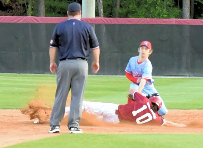 South Effingham junior outfielder Hunter Walthour (10) steals second base in the third inning with the Mustangs up 4-1 over the Heritage High School Patriots during a doubleheader Thursday in the GHSA Class 6A state playoffs in Guyton.