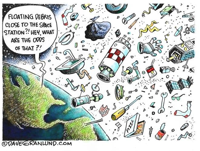 Granlund cartoon: Dangerous space junk. Dave Granlund cartoon on space debris.