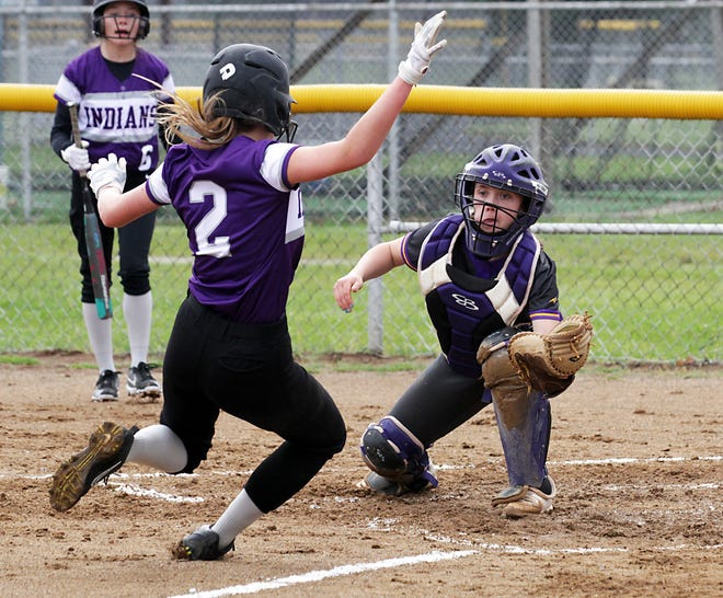 Bronson catcher Jaydn Cary prepares to tag out an Athens baserunner at home plate on Thursday evening.