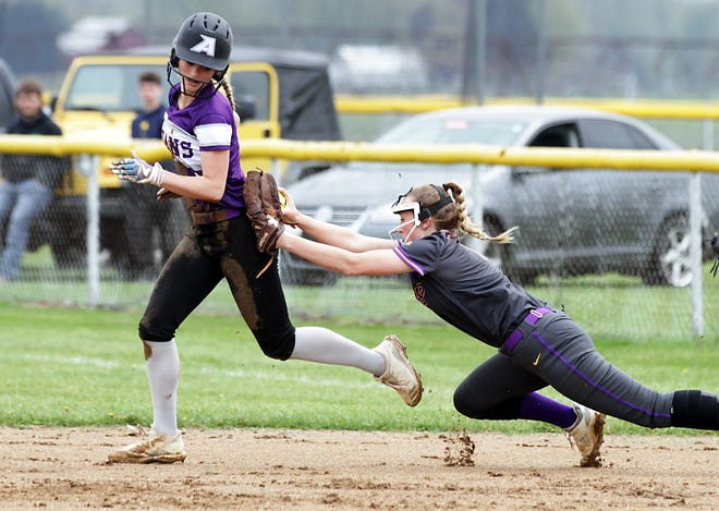 Addison Harris tags out an Athens baserunner during a rundown in prep softball action on Thursday.