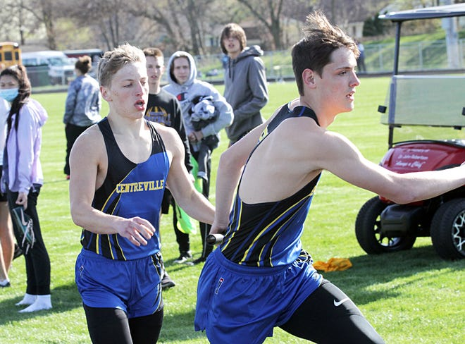 Gunner Bunning hands off the baton to Tyler Swanwick in the two-mile relay for Centreville. The Bulldog team is seeded first overall for the UAW meet.