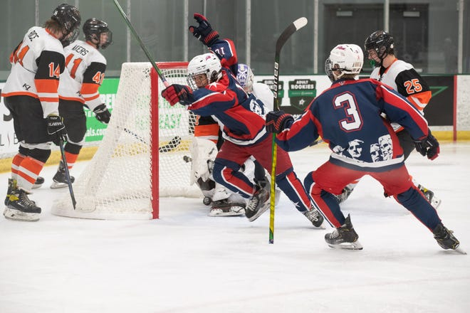Sioux Falls forward Alex Chan celebrates after scoring a goal for Team SD against the Nashville Flyers during the 14U national hockey tournament in Dallas, Texas. Team SD won 7-2.