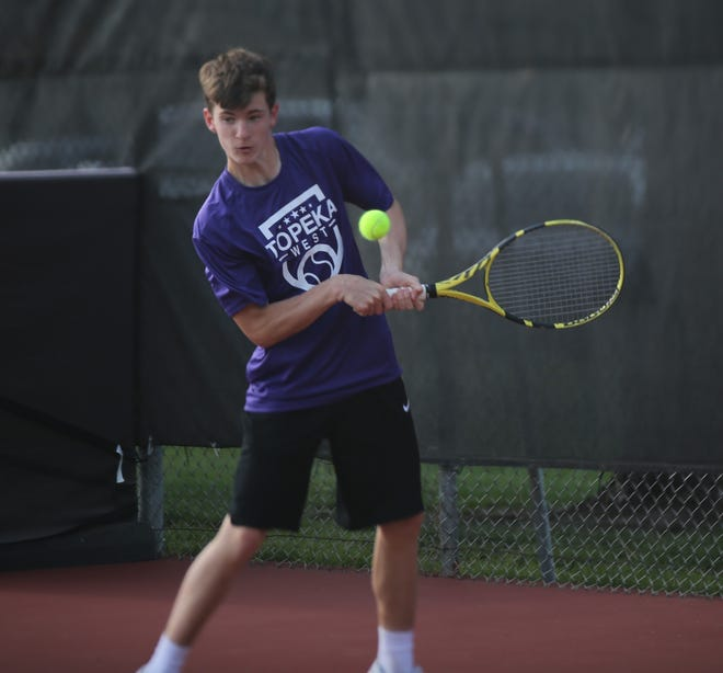 Topeka West's Ian Cusick teamed with twin brother Miles to capture the No. 1 doubles title at Thursday's City Tennis Championship. The Cusicks beat Washburn Rural's Nick Luetje and Mason Casebeer 8-1, helping the Chargers to their first city team championship.