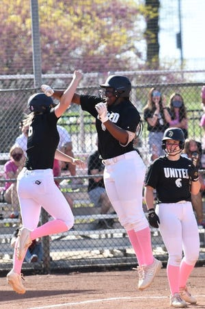 Topeka High's NiJaree Canady (middle) and Zoe Caryl (left) were two of four Trojans to earn first-team All-Class 6A honors from the Kansas Softball Coaches Association on Tuesday.