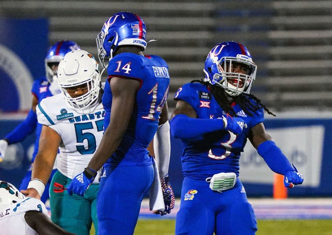 Kansas senior safety Ricky Thomas, right, and the Jayhawks will hold the team's annual spring game at 6 p.m. Saturday at David Booth Kansas Memorial Stadium in Lawrence.