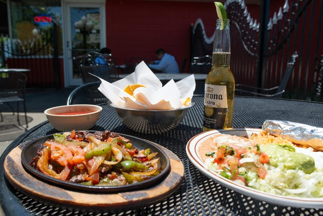 The lunch fajitas at El Mezcal are an delicious way to celebrate this year's Cinco De Mayo. The meal is $8.99 with your choice of steak or chicken; add a cerveza for a total of $14.01 with tax.