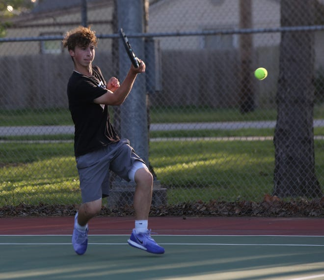 Topeka West sophomore Carter Cool returns a shot during his No. 1 singles championship match at Thursday's City Tennis Championships at Kossover Tennis Center. Cool defeated Shawnee Heights' Jaden Rodriguez 8-1 to wrap up the Chargers' first team city championship.