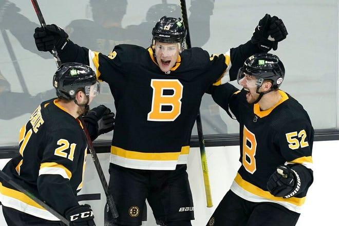 Bruins center Charlie Coyle celebrates his goal against the Buffalo Sabres on Thursday night at TD Garden.