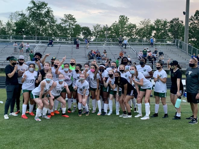 Pine Forest's girls' soccer team celebrates winning the Patriot Conference tournament championship 4-1 over Cape Fear on Thursday.