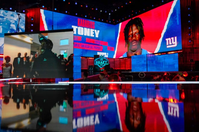 Images of Florida wide receiver Kadarius Toney are shown on stage Thursday after he was chosen by the New York Giants with the 20th pick in the first round of the NFL draft in Cleveland.