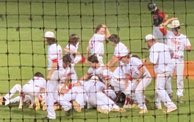 Santa Fe High players celebrate their district baseball title Thursday.