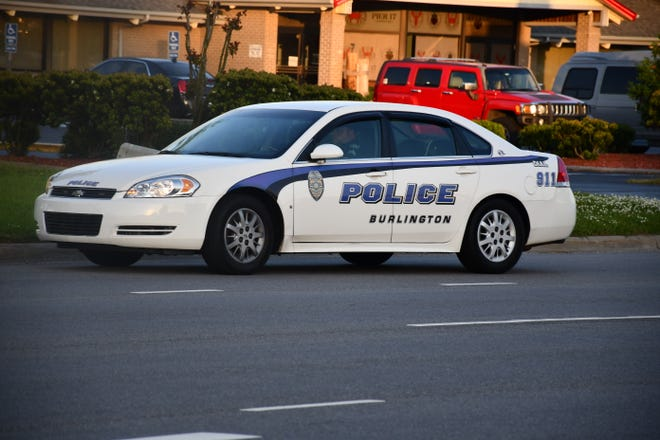 A Burlington police officer blocks the road for a protest in Elizabeth City on Wednesday, April 28. Burlington sent seven officers to help the Elizabeth City Police Department last week.
