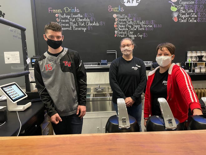 Employees Braden Overton (left) and Maddie Miller, along with owner Renee McClelland, make things happen at Missions Cafe.