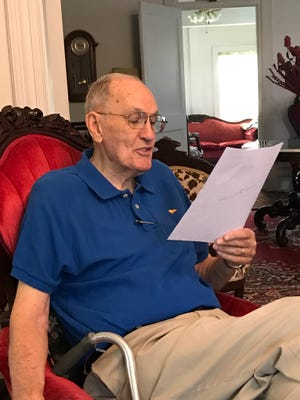 "Bob Mitchell, 90, reads from a letter informing him ""possible human remains"" had been found at the P-38 crash site in Austria connected to his brother 2nd. Lt. Henry Donald Mitchell on July 8, 1944 near Waldegg, Austria."