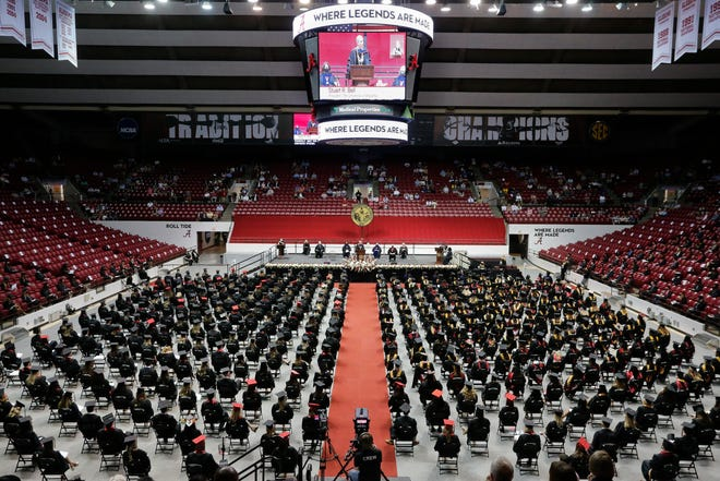 University of Alabama students gather on Friday April 30, 2021, during spring commencement ceremonies at Coleman Coliseum. Summer graduation exercises are set for July 31. [Staff Photo/Gary Cosby Jr.]