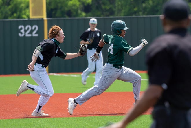 Waxahachie junior infielder Lucas Ferguson runs down a DeSoto base runner during a game last weekend. The Indians clinched a playoff berth with a 5-4 walk-off victory over Mansfield Lake Ridge at Richards Park.