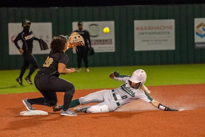 Waxahachie's Makenae Stone (0) slides in safely at third base during last weekend's victory over DeSoto at the Midkiff Athletic Complex. The Lady Indians trail their Class 6A Region II bi-district playoff series after a 9-3 loss to Bryan on Wednesday night.