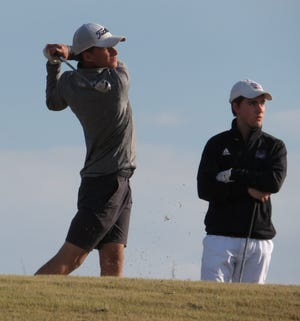 Waxahachie sophomore golfer Jud Willett follows through on his swing during tournament play this spring. Willett recently competed in the Class 6A Region II tournament in Waco.