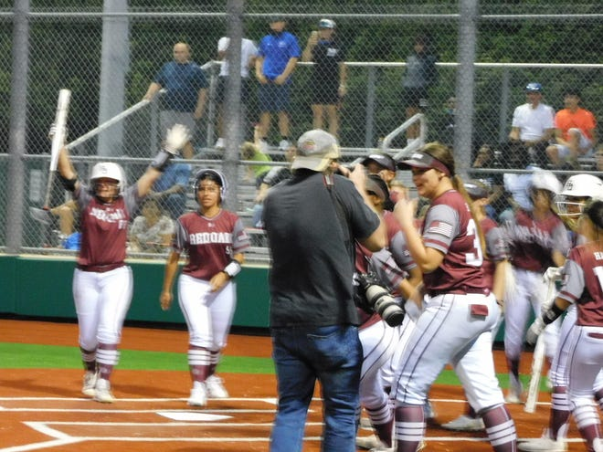 The Red Oak Lady Hawks celebrate after they came back to win 8-7 in the bottom of the seventh inning against North Forney on Wednesday evening at South Grand Prairie High School in Game 1 of a Class 5A Region II bi-district series.