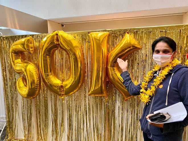Lahey Hospital & Medical Center's patient vaccination team administered its 50,000th dose of COVID-19 vaccine to Nasira Pethania, of Billerica.