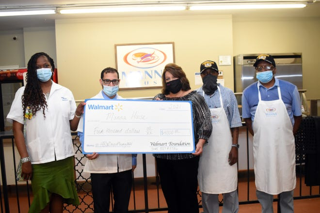 Walmart Neighborhood Pharmacies in Pineville and Alexandria donated $4,000 to the Manna House Friday as part of their Healthy Initiative. Yashard Gillard (far left), pharmacy manager at the Walmart Neighborhood Pharmacy in Alexandria; Yasser Abdelaziz and pharmacist at Walmart Neighborhood Pharmacy in Pineville made the check presentation to Jessica Viator, executive director of the Manna House, and staff members Illya Henderson and Jimmy Johnson.