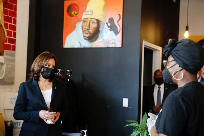 Vice President Kamala Harris speaks to Tsehai Henry, blaCk Coffee Lounge manager, while visiting the coffee shop during her America Back on Track tour on Friday, April 30, 2021, in Cincinnati. Harris is making her first official visit as vice president to Cincinnati.