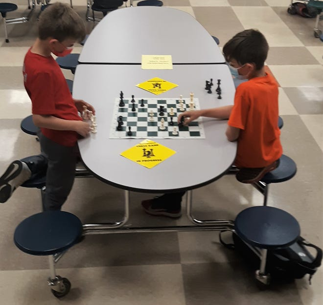 Brothers Jadon and Noah Smoulder play against each other in the Ridgewood Spring Open Chess Tournament. It was the first time brothers had squared off in the finals in the event's 32-year history.