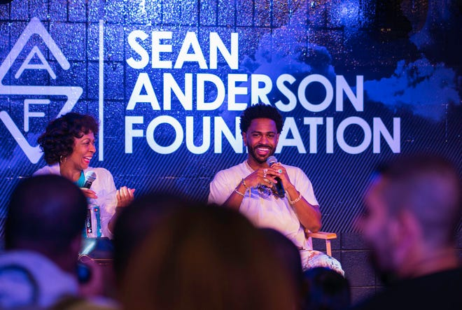 Big Sean, right, and his mother, Myra Anderson, on Aug. 17, 2019, at the Dauch Boys & Girls Club in Detroit.