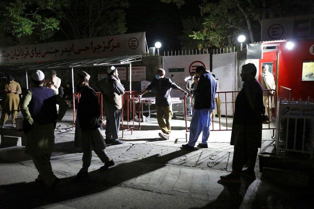 Suicide truck bomber hits Afghan guest house, killing 21 1