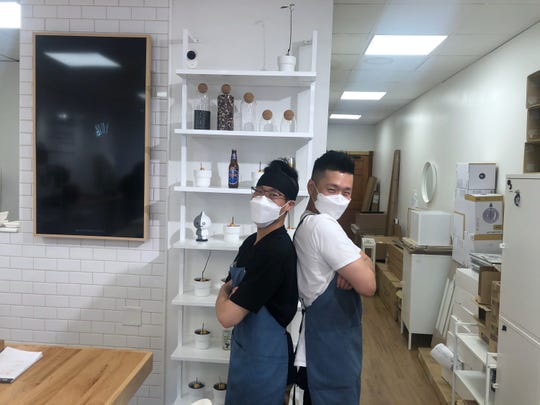 Chef Garry Huynh and co-owner Jo Cho pose at the Goblin's Clinton Township location.