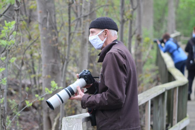 Magee Marsh Wildlife Area's popular boardwalk opened to birders Friday morning after being closed during the 2020 peak bird migration season. Visitors to the boardwalk are being limited to 100 per two-hour session and must register for a free permit to gain access. All birders must wear masks on the boardwalk.