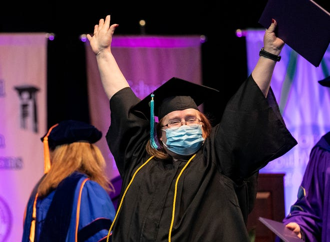 Shannon Haycraft celebrates getting her diploma during the commencement for Florida Southwestern State College on Friday, April 30, 2021, in Fort Myers.